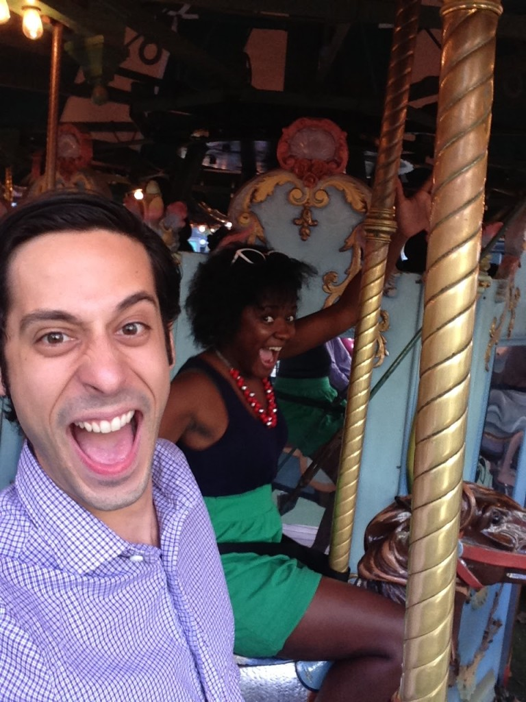 Erika and me celebrating Renata and Danny's wedding on a carousel in Bryant Park.